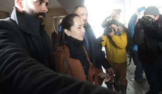 Huawei chief financial officer Meng Wanzhou, who is out on bail and remains under partial house arrest after she was detained last year at the behest of American authorities, leaves B.C. Supreme Court following a case management hearing, Friday, Jan. 17, 2020, in Vancouver, British Columbia. (Jonathan Hayward/The Canadian Press via AP)