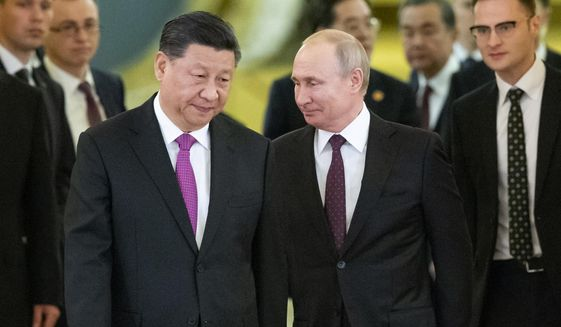 In this June 5, 2019, file photo, Russian President Vladimir Putin, center right, and Chinese President Xi Jinping, center left, enter a hall for the talks in the Kremlin in Moscow, Russia. (AP Photo/Alexander Zemlianichenko, Pool, File)