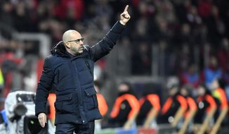 Leverkusen's head coach Peter Bosz gives instructions from the side line during the Champions League Group D soccer match between Bayer Leverkusen and Juventus at the BayArena in Leverkusen, Germany, Wednesday, Dec. 11, 2019. (AP Photo/Martin Meissner)