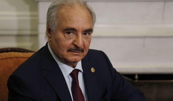 Libyan Gen. Khalifa Hifter joins a meeting with the Greek Foreign Minister Nikos Dendias in Athens, Friday, Jan. 17, 2020. The commander of anti-government forces in war-torn Libya has begun meetings in Athens in a bid to counter Turkey's support for his opponents. (AP Photo/Thanassis Stavrakis)