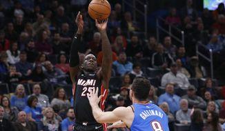 Miami Heat guard Kendrick Nunn (25) shoots over Oklahoma City Thunder forward Danilo Gallinari (8) in the first half of an NBA basketball game Friday, Jan. 17, 2020, in Oklahoma City. (AP Photo/Sue Ogrocki)