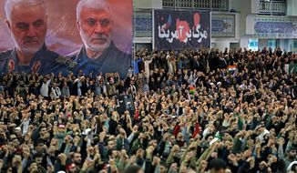 """In this picture released by the official website of the office of the Iranian supreme leader, worshippers chant slogans during Friday prayers ceremony, as a banner show Iranian Revolutionary Guard Gen. Qassem Soleimani, left, and Iraqi Shiite senior militia commander Abu Mahdi al-Muhandis, who were killed in Iraq in a U.S. drone attack on Jan. 3, and a banner which reads in Persian: """"Death To America, """"at Imam Khomeini Grand Mosque in Tehran, Iran, Friday, Jan. 17, 2020. Iran's supreme leader said in his sermons President Donald Trump is a """"clown"""" who only pretends to support the Iranian people but will """"push a poisonous dagger"""" into their backs, as he struck a defiant tone in his first Friday sermon in Tehran in eight years. (Office of the Iranian Supreme Leader via AP)"""