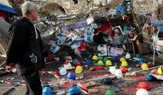 Posters of protesters who have been killed in anti-government demonstrations and their belongings are displayed in Tahrir Square, in Baghdad, Iraq, Friday, Jan. 17, 2020. (AP Photo/Hadi Mizban)