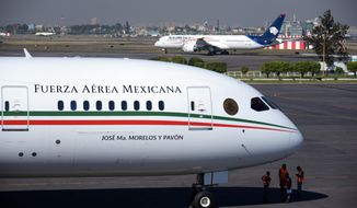 This Dec. 3, 2018 photo provided by the Mexican Presidential press office shows the presidential airplane at the presidential hangar at Benito Juarez International Airport in Mexico City. Mexican President Andres Manuel López Obrador has made selling off the luxurious presidential jet a centerpiece of his austerity program, but there's just one problem: Nobody, it seems, wants to buy the white elephant. (Mexican Presidential press office via AP)