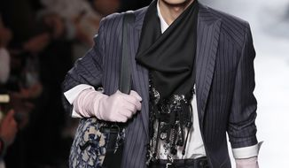 A model presents a creation for the Dior Homme Mens Fall/Winter 2020-2021 fashion collection presented in Paris, Friday Jan. 17, 2020. (AP Photo/Francois Mori)