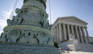 In this June 17, 2019 file photo, The Supreme Court is seen in Washington. The Supreme Court will consider Trump administration rules expanding religious, moral exemptions from contraceptive coverage.  (AP Photo/J. Scott Applewhite) **FILE**