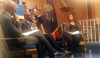 """In this Jan. 16, 2020, photo, from left, Harrison Floyd and Paris Dennard of President Donald Trump's reelection campaign black voter outreach effort and Kamilah Prince, the Republican National Committee's director of African American engagement participate in """"Black Voices for Trump"""" event at Philadelphia's First Immanuel Baptist Church. Trump's reelection campaign is reaching out to black voters through one of their communities' most important institutions — black churches.  (AP Photo/Elana Schor) **FILE**"""