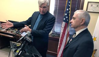U.S. Sens. Sheldon Whitehouse, left, and Jack Reed discuss the impeachment trial of President Donald Trump Friday, Jan. 17, 2020, at Reed's office in Cranston, R.I. The Rhode Island Democrats spoke about the importance of calling witnesses for the trial. (AP Photo/Jennifer McDermott)