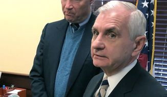 U.S. Sens. Jack Reed, front, and Sheldon Whitehouse discuss the impeachment trial of President Donald Trump, Friday, Jan. 17, 2020, at Reed's office in Cranston, R.I. The Rhode Island Democrats spoke about the importance of calling witnesses for the trial. (AP Photo/Jennifer McDermott) **FILE**