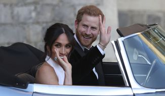 Meghan Markle and Prince Harry, leave Windsor Castle in a convertible car after their wedding in Windsor, England, to attend an evening reception at Frogmore House. (Steve Parsons/pool photo via AP, File)