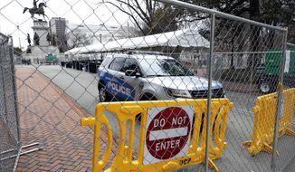 Barriers are set up at the Virginia State Capitol in Richmond on Saturday, Jan. 18, 2019, in anticipation of a rally by a large number of gun-rights backers on Monday. An unprecedented show of force by gun-rights activists is expected on Monday in Virginia. They are angry over the state's new Democratic majority leadership and its plans to enact a slew of gun restrictions. Thousands of gun activists are expected to turn out. Second Amendment groups have identified the state as a rallying point for the fight against what they see as a national erosion of gun rights. (Joe Mahoney/Richmond Times-Dispatch via AP)