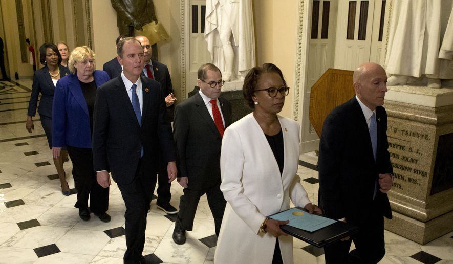 In this Jan. 15, 2020 file photo, House Sergeant at Arms Paul Irving and Clerk of the House Cheryl Johnson deliver the articles of impeachment against President Donald Trump to Secretary of the Senate Julie Adams on Capitol Hill in Washington.  Following are impeachment managers, House Judiciary Committee Chairman, Rep. Jerrold Nadler, D-N.Y., House Intelligence Committee Chairman Adam Schiff, D-Calif., Rep. Hakeem Jeffries, D-N.Y., Rep. Sylvia Garcia, D-Texas, Rep. Val Demings, D-Fla., Rep. Zoe Lofgren, D-Calif., and Rep. Jason Crow, D-Colo. (AP Photo/Jose Luis Magana, Pool)