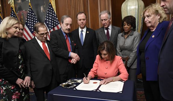 In this Jan. 15, 2020 file photo, House Speaker Nancy Pelosi of Calif., signs the resolution to transmit the two articles of impeachment against President Donald Trump to the Senate for trial on Capitol Hill in Washington.Pelosi  is surrounded by, from left, House Oversight and Government Reform Committee Chair Rep. Carolyn Maloney, D-N.Y., Rep. Sylvia Garcia, D-Texas, House Judiciary Committee Rep. Jerrold Nadler, D-N.Y., House Foreign Affairs Committee Chairman Rep. Eliot Engel, D-N.Y., House Intelligence Committee Chairman Adam Schiff, D-Calif., House Ways and Means Committee Chairman Rep. Richard Neal, D-Mass., House Financial Services Committee Chairwoman Maxine Waters, D-Calif., Rep. Zoe Lofgren, D-Calif., and Rep. Jason Crow, D-Colorado.  House Democrats were preparing to outline their case for removing Trump from office in a legal brief due Saturday, Jan. 18, as opposing sides in the impeachment case look ahead to the opening of the historic trial in the Senate.(AP Photo/Susan Walsh) **FILE**