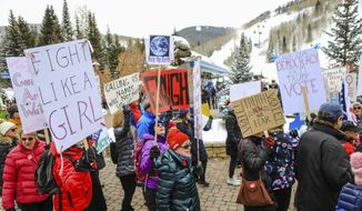 People participate in the Women's March in Vail, Colo., Saturday, Jan. 18, 2020. Thousands gathered in cities across the country Saturday as part of the nationwide Women's March rallies focused on issues such as climate change, pay equity, reproductive rights and immigration. (Chris Dillmann/Vail Daily via AP)