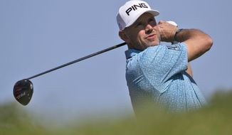 England's Lee Westwood tees off on the 3rd hole during the third round of the Abu Dhabi Championship golf tournament in Abu Dhabi, United Arab Emirates, Saturday, Jan. 18, 2020. (AP Photo/Kamran Jebreili)