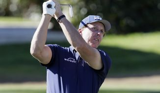 Phil Mickelson follows through on the fourth tee during the third round of The American Express golf tournament on the Stadium Course at PGA West in La Quinta, Calif., Saturday, Jan. 18, 2020. (AP Photo/Alex Gallardo)