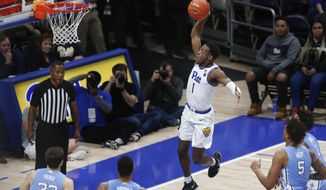 Pittsburgh's Xavier Johnson (1) goes up and makes a basket in front of North Carolina's Armando Bacot (5), Garrison Brooks (15) and Justin Pierce (32) during the first half of an NCAA college basketball game, Saturday, Jan. 18, 2020, in Pittsburgh. (AP Photo/Keith Srakocic)