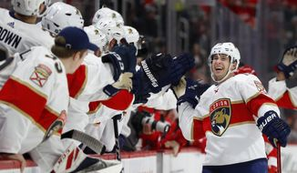 Florida Panthers defenseman Mark Pysyk is congratulated for his goal against the Detroit Red Wings during the first period of an NHL hockey game Saturday, Jan. 18, 2020, in Detroit. (AP Photo/Paul Sancya)