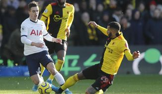Tottenham's Giovani Lo Celso, left, is tailed by Watford's Etienne Capoue during the English Premier League soccer match between Watford and Tottenham Hotspur at Vicarage Road, Watford, England, Saturday, Jan. 18, 2020. (AP Photo/Frank Augstein)