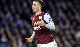 Aston Villa's Jack Grealish celebrates scoring his side's first goal of the game during the English Premier League soccer match between Brighton and Hove Albion and Aston Villa at the AMEX stadium, Brighton, England. Saturday, Jan. 18, 2020. (Gareth Fuller/PA via AP)
