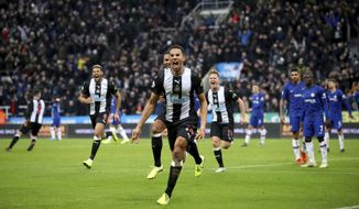 Newcastle United's Isaac Hayden, centre, celebrates scoring his side's first goal of the game during their English Premier League soccer match against Chelsea at St James' Park, Newcastle, England, Saturday, Jan. 18, 2020. (Owen Humphreys/PA via AP)