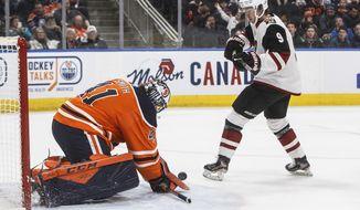 Arizona Coyotes' Clayton Keller (9) is stopped by Edmonton Oilers goalie Mike Smith (41) during third period NHL action in Edmonton, Alberta, on Saturday, Jan. 18, 2020. (Jason Franson/The Canadian Press via AP)