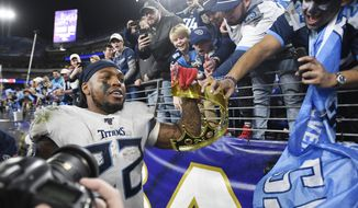 In this Saturday, Jan. 11, 2020 photo, Tennessee Titans running back Derrick Henry (22) gets a crown from fan Mohammed Khan after the team's 28-12 win over the Baltimore Ravens in an NFL Divisional Playoff game at M&T Bank Stadium in Baltimore, Md. (Ricky Rogers/The Tennessean via AP)