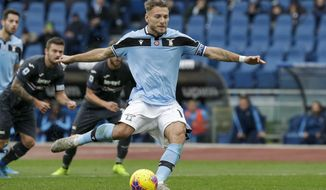 Lazio's Ciro Immobile scores his side's second goal on a penalty shot during a Serie A soccer match between Lazio and Sampdoria, at Rome's Olympic Stadium, Saturday, Jan. 18, 2020. (AP Photo/Andrew Medichini)