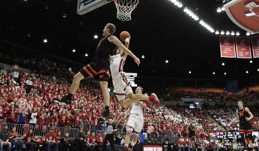 Washington State forward CJ Elleby (2) shoots while pressured by Oregon State guard Zach Reichle (11) during the second half of an NCAA college basketball game in Pullman, Wash., Saturday, Jan. 18, 2020. Washington State won 89-76. (AP Photo/Young Kwak)