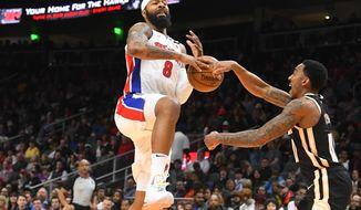 Detroit Pistons forward Markieff Morris (8) has the ball stripped from him by Atlanta Hawks guard Jeff Teague during the second half of an NBA basketball game Saturday, Jan. 18, 2020, in Atlanta. (AP Photo/John Amis)