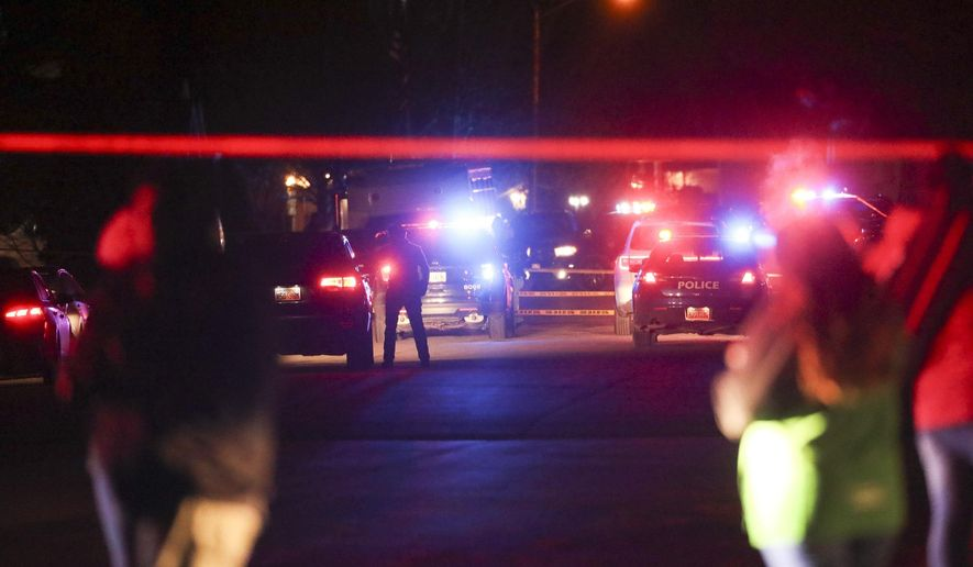 Police investigate after four people were killed and a fifth person was injured in a shooting at a Grantsville, Utah, home Friday, Jan. 17, 2020. The suspected shooter was taken into custody by Grantsville police, the Deseret News reported. Grantsville Mayor Brent Marshall said the victims and the shooter are all related, the newspaper reported. (Steve Griffin/The Deseret News via AP)