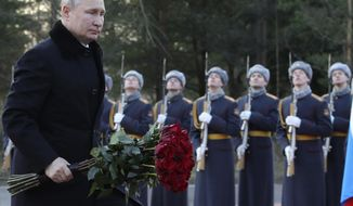 President Vladimir Putin attends a wreath laying commemoration ceremony for the 77th anniversary since the Leningrad siege was lifted during the World War Two at the Boundary Stone monument, around 50 kilometers east of St.Petersburg, Russia, Saturday, Jan. 18, 2020. (Alexei Danichev, Sputnik, Kremlin Pool Photo via AP)