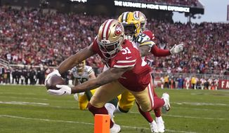 San Francisco 49ers running back Raheem Mostert (31) scores in front of Green Bay Packers free safety Darnell Savage during the first half of the NFL NFC Championship football game Sunday, Jan. 19, 2020, in Santa Clara, Calif. (AP Photo/Tony Avelar)