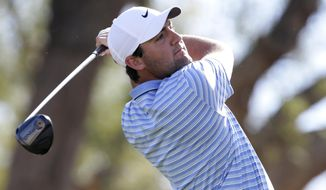 Scott Scheffler follows through on the third tee during the final round of The American Express golf tournament on the Stadium Course at PGA West in La Quinta, Calif., Sunday, Jan. 19, 2020. (AP Photo/Alex Gallardo)
