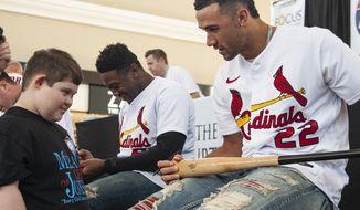 St. Louis Cardinals pitcher Jack Flaherty, right, talks with Brant Ballard, 15, before signing his baseball bat during the annual Cardinals Caravan event on Saturday, Jan. 18, 2020, in Jonesboro, Ark. (Quentin Winstine/The Jonesboro Sun via AP)