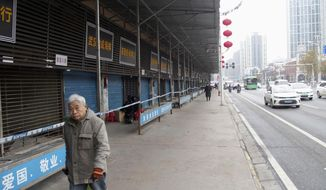 This Jan. 17, 2020, file photo, shows the closed Huanan Seafood Wholesale Market in Wuhan, China. China reported Monday, Jan. 20, a sharp rise in the number of people affected in a pneumonia outbreak caused by a new coronoavirus, including the first cases in the capital. (Kyodo News via AP)