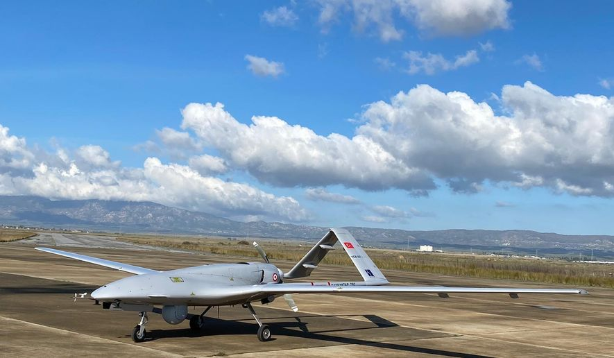 A Turkish-made Bayraktar TB2 drone is seen shortly after its landing at an airport in Gecitkala, known as Lefkoniko in Greek, in Cyprus, Monday, Dec. 16, 2019. Turkey has dispatched the surveillance and reconnaissance drone to the breakaway north of ethnically divided island nation of Cyprus amid tensions over offshore oil and gas exploration. It's unclear what the drones will be specifically tasked to do.Turkey doesn't recognize Cyprus as a state and asserts that 44% of the island nation's exclusive economic zone are its own. (DHA via AP)
