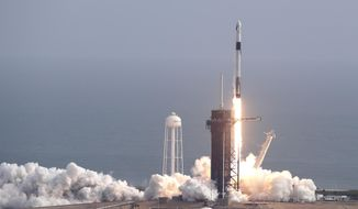 A Falcon 9 SpaceX rocket lifts off from pad 39A during a test flight to demonstrate the capsule's emergency escape system at the Kennedy Space Center in Cape Canaveral, Fla., Sunday, Jan. 19, 2020. (AP Photo/John Raoux)