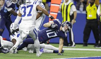 Tennessee Titans wide receiver Adam Humphries (10) reaches in for a touchdown in front of Indianapolis Colts safety Khari Willis (37) during the first half of an NFL football game in Indianapolis, Sunday, Dec. 1, 2019. (AP Photo/Darron Cummings)  **FILE**