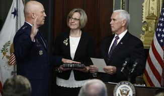 Vice President Mike Pence, right, swears in Air Force General John Raymond as Chief of Space Operations, as his wife, Molly, center, holds a bible in the Vice President's Ceremonial Office at the Executive Office Building, Tuesday, Jan. 14, 2020 in Washington. (AP Photo/Steve Helber)  **FILE**