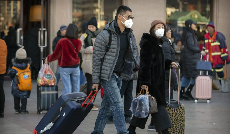 China has reported a sharp rise in the number of people infected with a new coronavirus, including the first cases in the capital. The outbreak coincides with the country's busiest travel period, as millions board trains and planes for the Lunar New Year holidays. (Associated Press)