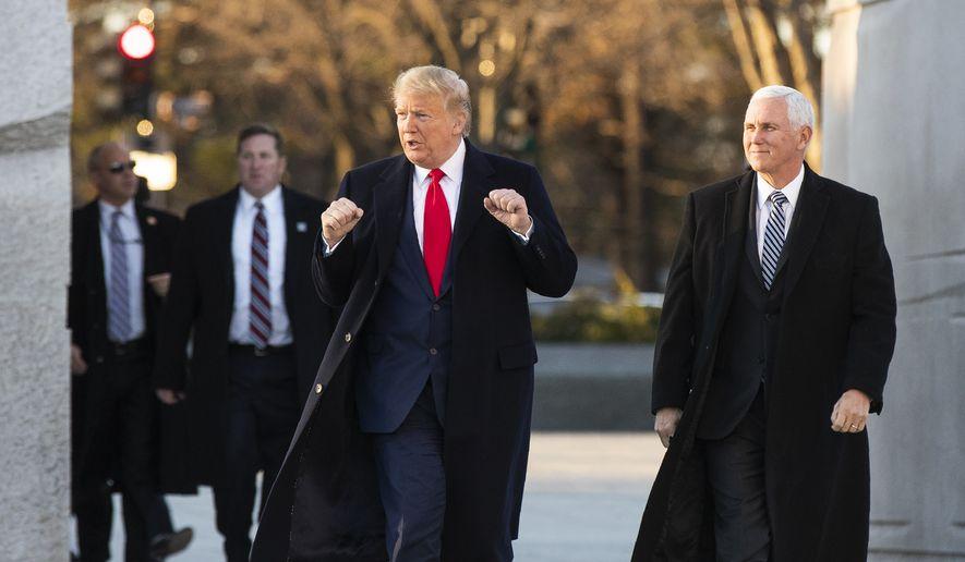 President Donald Trump and Vice President Mike Pence visit the Martin Luther King Jr. Memorial, Monday, Jan. 20, 2020, in Washington. (AP Photo/Manuel Balce Ceneta)