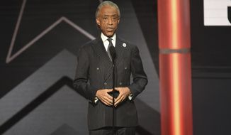 """FILE - This June 23, 2019 file photo shows Al Sharpton presenting an award at the BET Awards in Los Angeles. Sharpton is working on a book meant to address what he calls an urgent moment in American history. Hanover Square Press announced Monday that the longtime civil rights activist's """"Rise Up: Confronting a Country at the Crossroads"""" is coming out Sept. 15.(Photo by Chris Pizzello/Invision/AP, File)"""