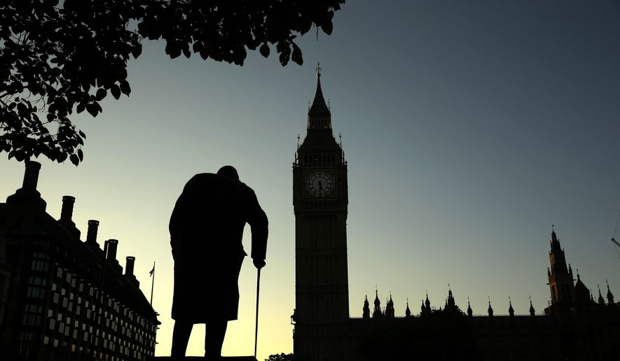 In this Friday, June 24, 2016, file photo a statue of Winston Churchill is silhouetted against the Houses of Parliament and the early morning sky in London, Friday, June 24, 2016. A day earlier, Britain had voted to leave the European Union in a referendum. On Jan. 31, 2020, Britain is scheduled to leave the EU after 47 years of membership. (AP Photo/Matt Dunham, File)
