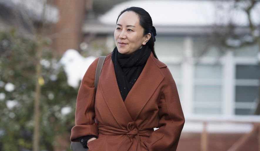 In this  Jan. 17, 2020, file photo, Huawei chief financial officer Meng Wanzhou, who is out on bail and remains under partial house arrest after she was detained last year at the behest of American authorities, leaves her home in Vancouver, British Columbia, as she heads to B.C. Supreme Court for a case management hearing. The first stage of her extradition hearing begins Monday, Jan. 20, 2020, in a Vancouver courtroom, a case that has infuriated Beijing, set off a diplomatic furor and raised fears of a brewing tech war between China and the United States. (Jonathan Hayward/The Canadian Press via AP, File)