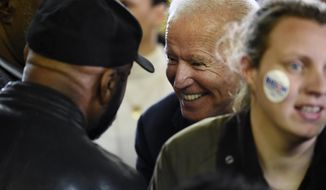Democratic presidential candidate and former Vice President Joe Biden speaks with supporters after speaking at an oyster roast campaign event on Sunday, Jan. 19, 2020, in Orangeburg, S.C. (AP Photo/Meg Kinnard)