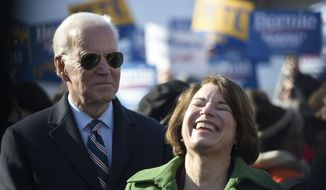 Democratic presidential hopefuls Joe Biden and Amy Klobuchar stand together before a Martin Luther King Jr. Day march on Monday, Jan. 20, 2020, in Columbia, S.C. (AP Photo/Meg Kinnard) ** FILE **