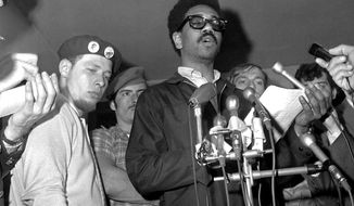 """FILE - In this June 4, 1969, file photo, Bobby Rush, deputy defense minister of the Illinois Black Panther party, center, reads a statement at a news conference after an early morning raid on Chicago Panther headquarters by FBI agents. At left is Jose """"Cha Cha"""" Jimenez, chairman of the Young Lord, a Chicago-area Puerto Rican group. """"The First Rainbow Coalition,"""" a new PBS documentary, is exploring a little-known movement in 1960s Chicago that brought together blacks, Latinos, and poor whites from Appalachia that later resulted in the upending of politics in the American Midwest. (AP Photo/EK, File)"""