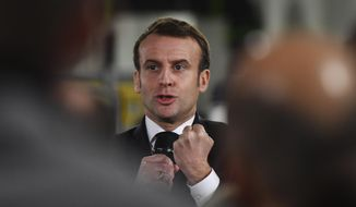 French President Emmanuel Macron delivers a speech as he visits a plant of British-Swedish pharmaceutical group Astrazeneca in Dunkirk, northern France, Monday, Monday, Jan. 20, 2020. French President Emmanuel Macron is hosting 180 international business leaders at the Palace of Versailles in a bid to promote France's economic attractiveness despite over six weeks of crippling strikes over his government's planned pension changes.(Denis Charlet/Pool Photo via AP)