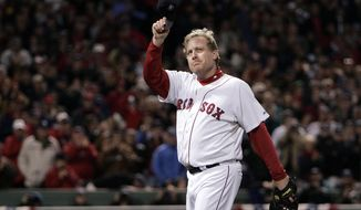 FILE - In this Oct. 25, 2007, file photo, Boston Red Sox pitcher Curt Schilling (38) tips his hat as he walks off the field after being taken out of the game during the sixth inning in Game 2 of the baseball World Series against the Colorado Rockies at Fenway Park in Boston. Schilling is on the 2020 Hall of Fame ballot. On Tuesday, Jan. 21, 2020, the Baseball Writers' Association of America will announce the results of its 2020 Hall of Fame balloting. ((AP Photo/Winslow Townson, File)